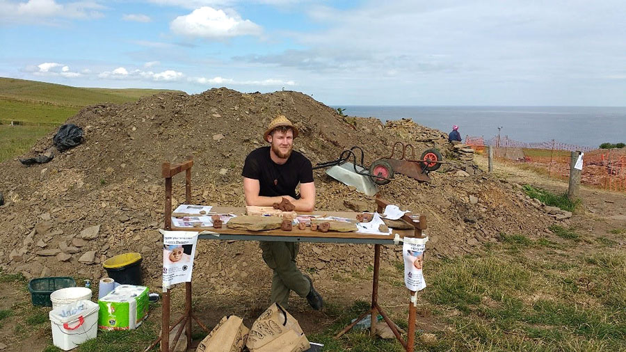 Ross Drummond, digging on the Orkneys as part of his MSc in Archaeology