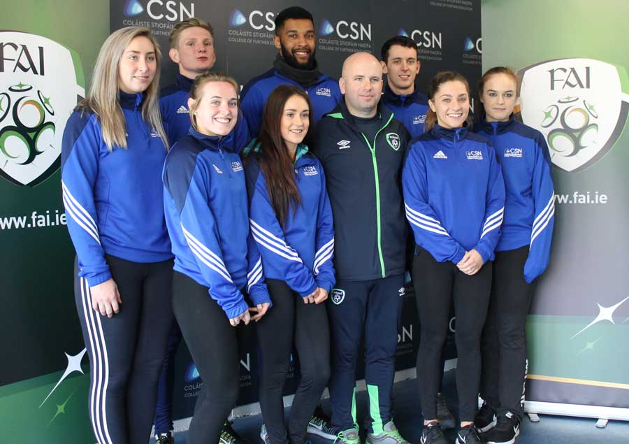 Niall O'Regan of the FAI presenting awards to CSN Sports students